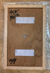 The back side of a finished panel with the backing plate screwed into place.